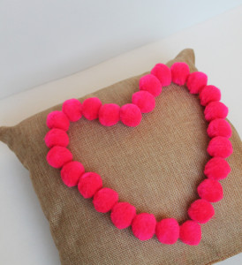 Heart-shaped pom poms  Valentine's Day Pillow Idea